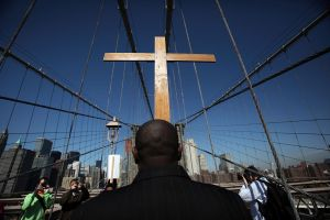 Way Of The Cross Procession Crosses Over New York's Brooklyn Bridge