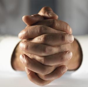 Close up on Two Hands Folded Together