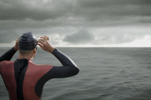 Swimmer looking out at ocean