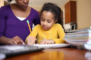Mom helping daughter with school work.