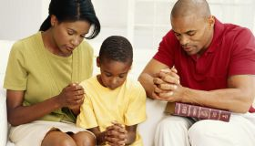 Parents with son (6-9) praying