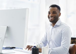 A handsome young african american businessman working at his desk