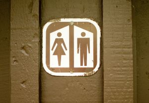 Women/Man sign on out house