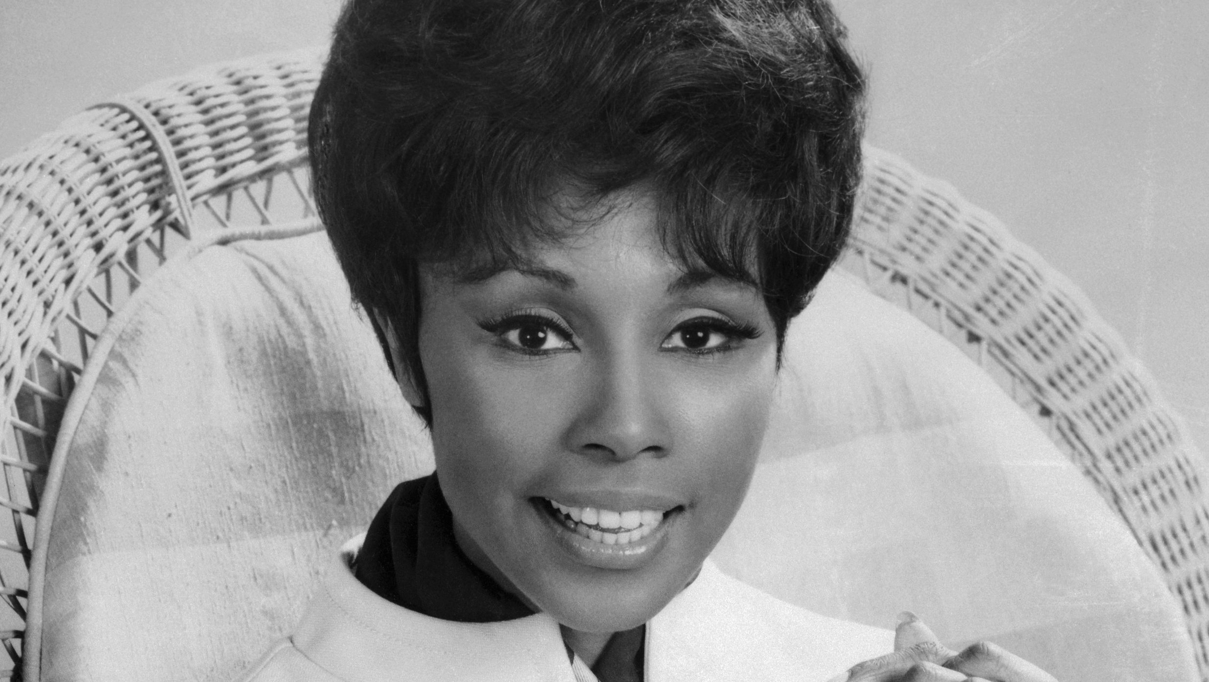 Diahann Carroll Sitting with Hands Clasped