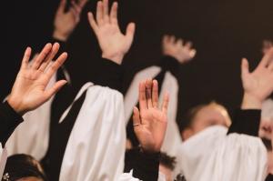 Church Choir's Hands Raised