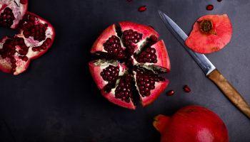 Ripe pomegranate fruit on vintage background