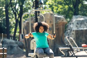 African woman doing fitness workout in park