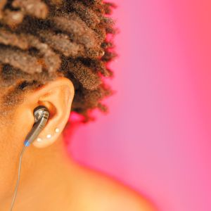 Earphone in Womans Ear