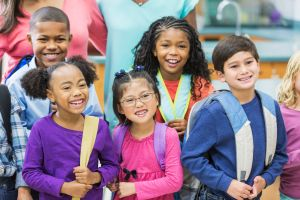 Multi-ethnic group of children in school