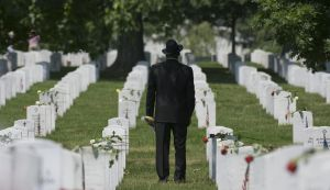 ARLINGTON, VA - MAY 30: A visitor to Arlington Cemetery pays his