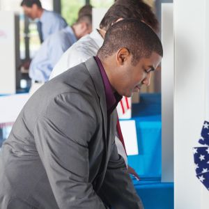 Man voting at a busy vote location