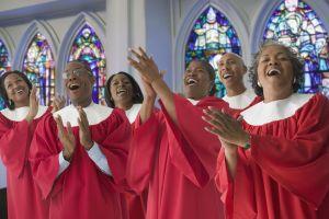 African men and women in church choir singing