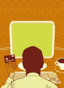 Man holding credit card using computer