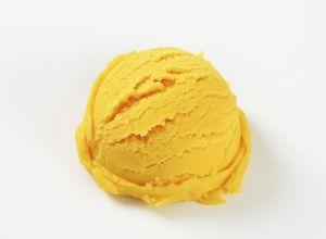 Scoop of yellow ice cream - studio shot