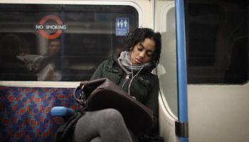 Woman sleeping on train