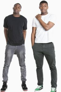 Portrait of two young men in casuals over gray background